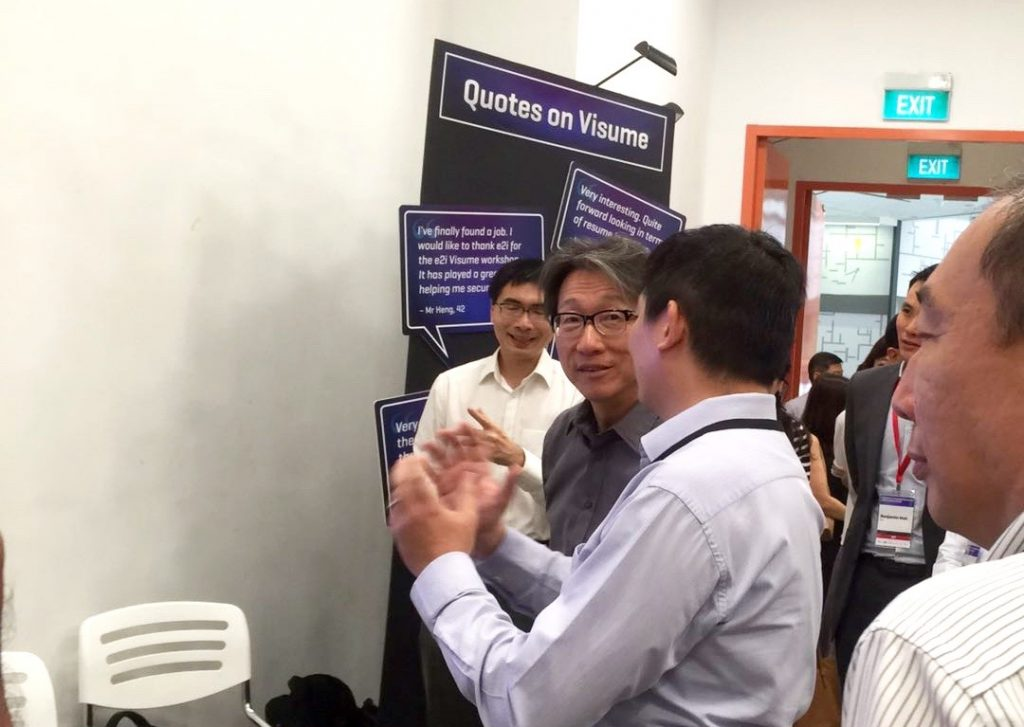 Mr. Heng Chong Ming explaining his visume building experience to Minister of Manpower Mr. Lim Swee Say